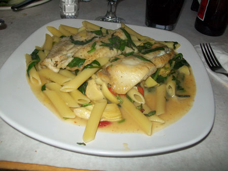 Pan roasted fluke with artichoke hearts, roasted peppers, spinach, basil & white wine sauce. Served with penne pasta